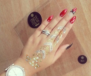 red nails, silver rings, and silver watch image