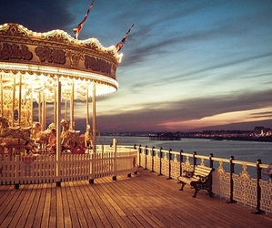 carousel, light, and sky image