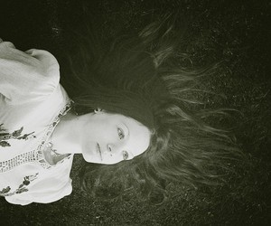 black and white, girl, and grass image