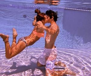 couple, pool, and kiss image