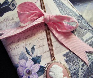 cameo, flower, and ribbon image