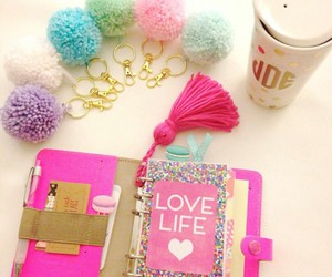 pink notebooks, white coffee cup, and diy keychains image