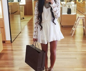 white romper, black curled hair, and lace romper image