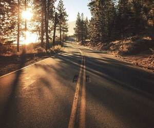 road, sun, and trees image