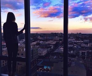 girl, city, and sky image