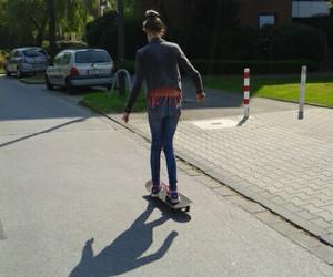skate board, street, and sun image