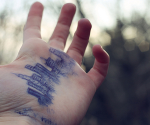 hand, city, and art image