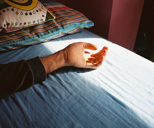 bed, hand, and cute image