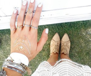 white nails, silver bracelets, and beige ankle booties image