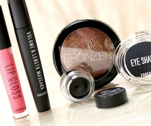 makeup, mascara, and bronzer image