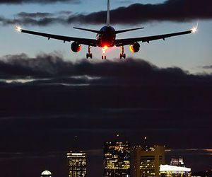 city, night, and plane image