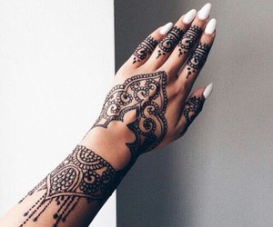 white claw nails and black henna tattoos image
