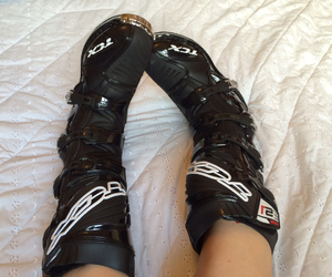 bed, boots, and dirtbike image
