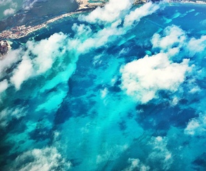 ocean, clouds, and fly image