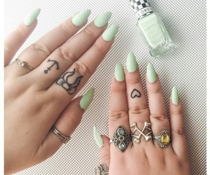 rings, finger tattoos, and mint green nails image