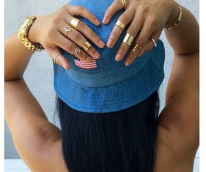 gold rings, straight black hair, and gold bracelets image