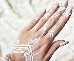 long beige nails and white henna tattoos image