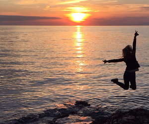 sunset, girl, and sea image