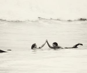 beach, couple, and ocean image