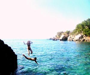 girls, jump, and landscape image
