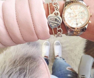 bracelet, watch, and jacket image