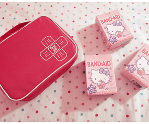 hello kitty, pink, and band aid image