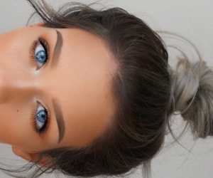 makeup, blue eyes, and bun image