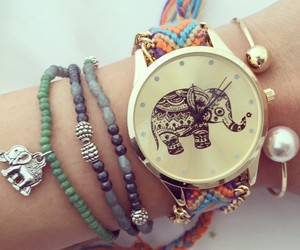 bracelets, clock, and elephant image