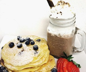 blueberries, strawberries, and whipped cream image