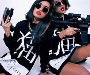 girl, gun, and hair image