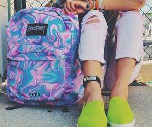 blue rings, colorful bracelets, and colorful backpack image