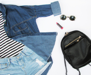 bagpack, lipstick, and denim image