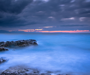 cloudy sky and blue waters image