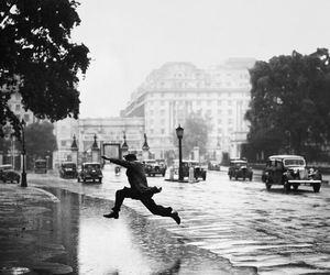 black and white, jump, and rain image