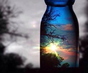 sun, sunset, and bottle image