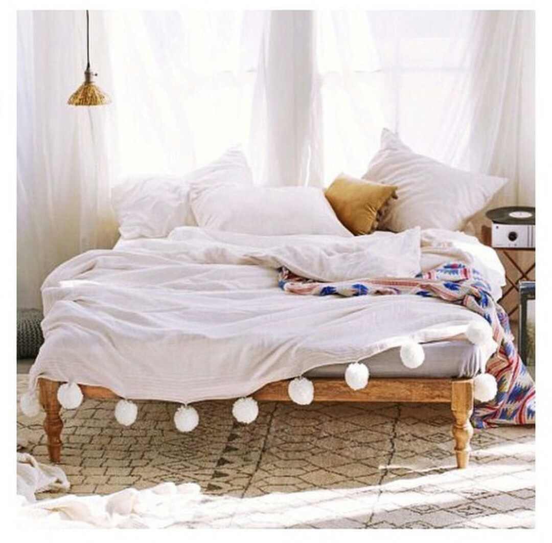 record player, rugs, and white pillows image
