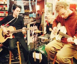 Matt Bellamy, dom howard, and chris wolstenholme image