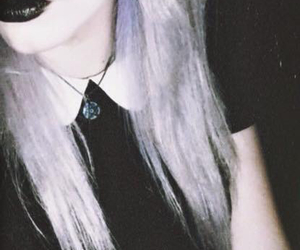 black lips, dyed hair, and indie image