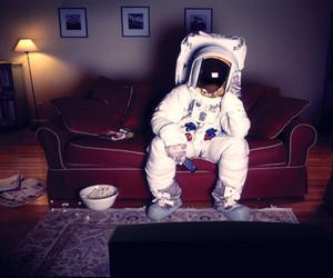 astronaut, tv, and popcorn image