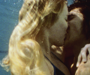 couple, kiss, and water image