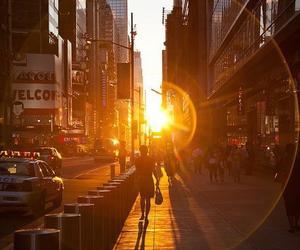 city, sun, and sunset image