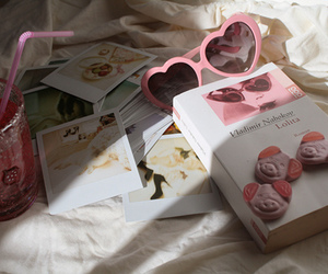 book, sunglass, and drink image