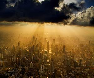 city, sky, and sun image