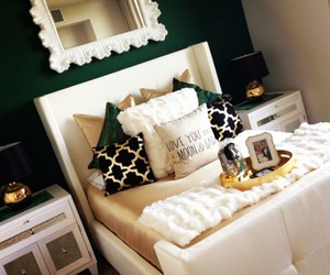 white pillows, gold lamps, and white mirrors image