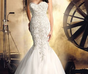 wedding dresses, gold jewellery, and bridal gowns image