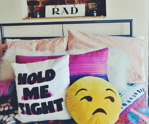 rad, white pillow, and colorful blankets image