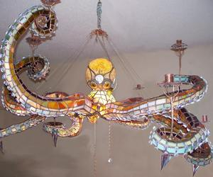 octopus, candelabrum, and stained glass image