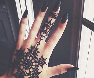 matte black nails and black henna tattoos image