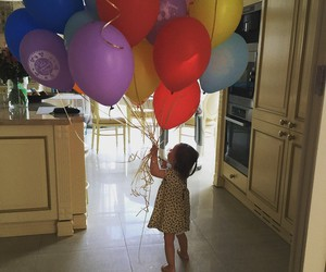 baby and balloons image