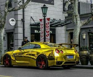 gold, shiny, and skyline image
